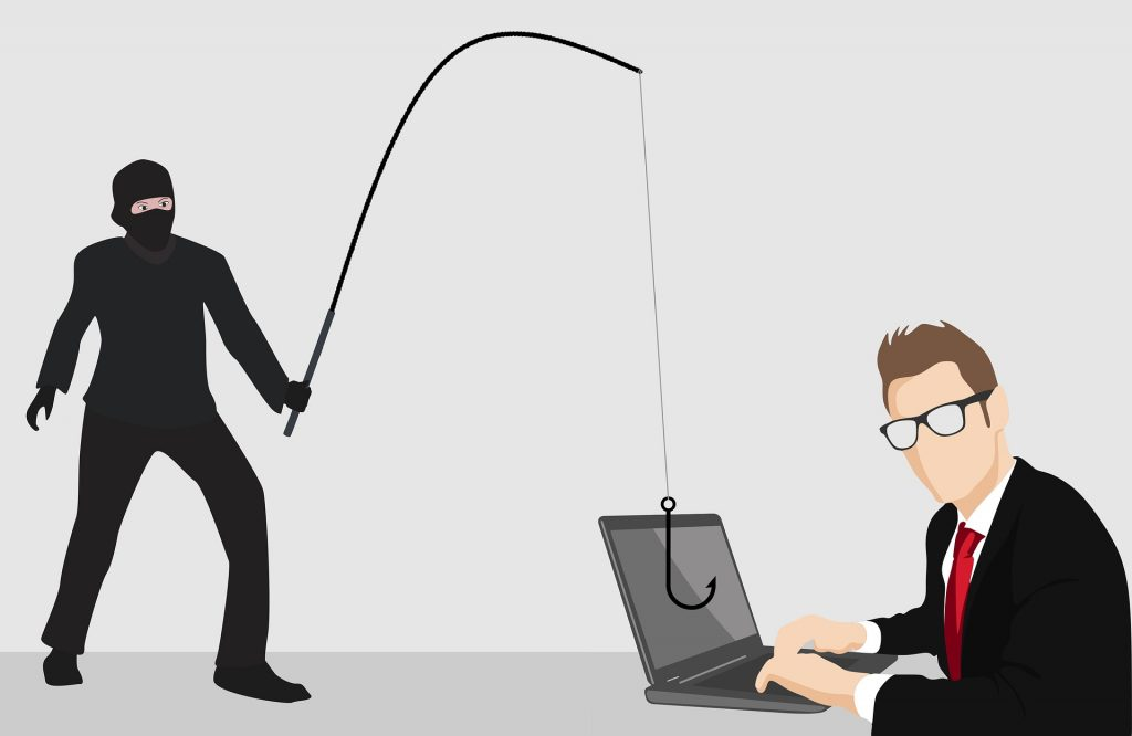 Man researching phishing statistics
